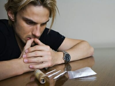 Man Staring at Lines of Cocaine